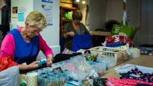 Working in the sorting area at Yorkshire Cat Rescue charity shop