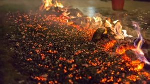 Image of a firewalk after it has been lit before anyone has walked on it